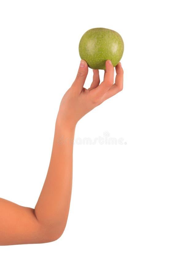 Las manos de la mujer con la manzana aislada sobre el fondo blanco fotos de archivo libres de regalías