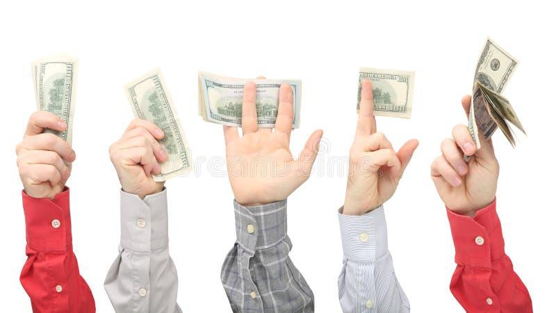 Las manos de los hombres que llevan a cabo billetes de d?lar con el dinero en el fondo blanco fotografía de archivo libre de regalías