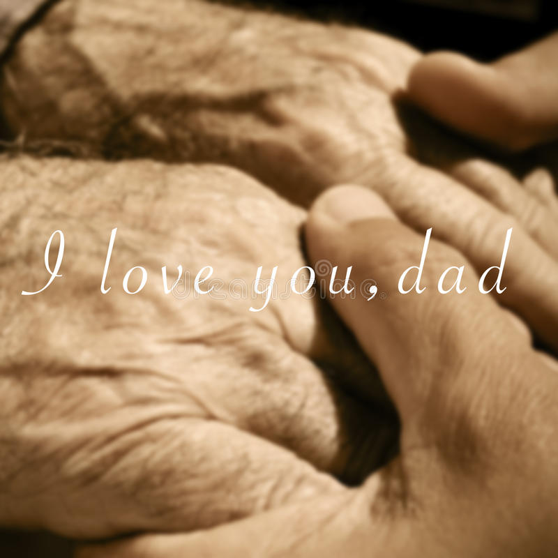 Las manos de un hombre joven que lleva a cabo las manos de un viejo hombre y fotografía de archivo