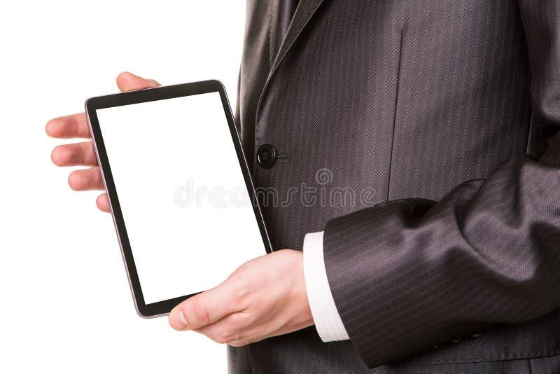 Las manos del hombre de negocios que muestran un comuter de la PC de la tableta con la pantalla en blanco para su texto de la mues foto de archivo