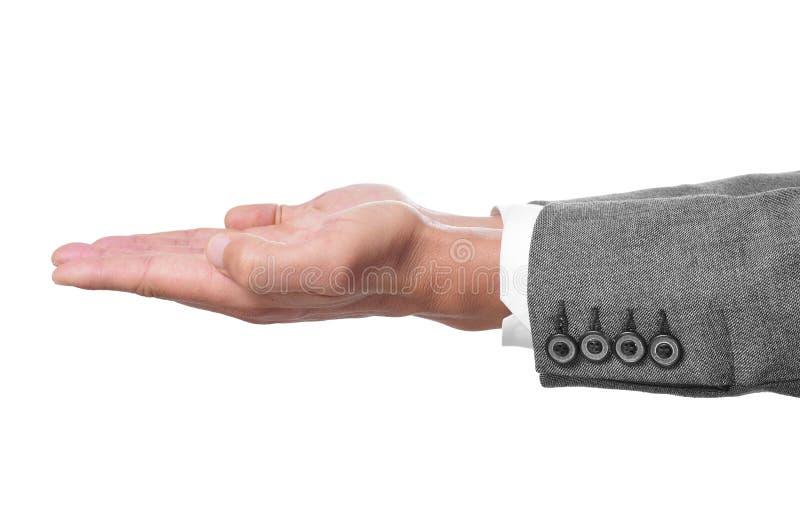Las manos del hombre se abren como mostrando o llevando a cabo algo fotos de archivo