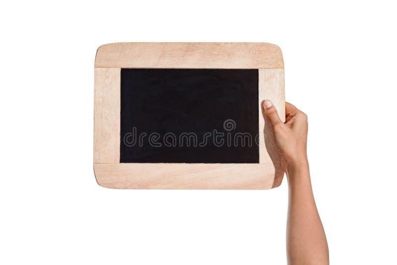 Las manos femeninas que sostienen la pizarra suben, pizarra aislada imagen de archivo libre de regalías