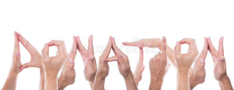 Las manos forman la donación de la palabra imagen de archivo libre de regalías