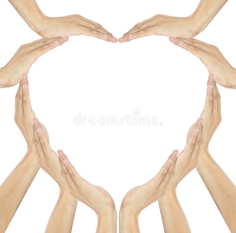 Las manos humanas hacen dimensión de una variable del corazón imagen de archivo libre de regalías