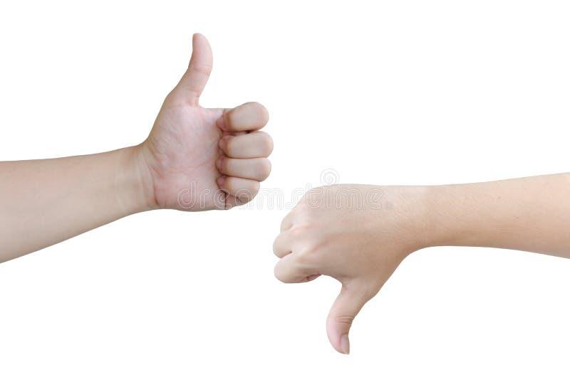 Las manos muestran como y aversión, en el fondo blanco fotografía de archivo libre de regalías