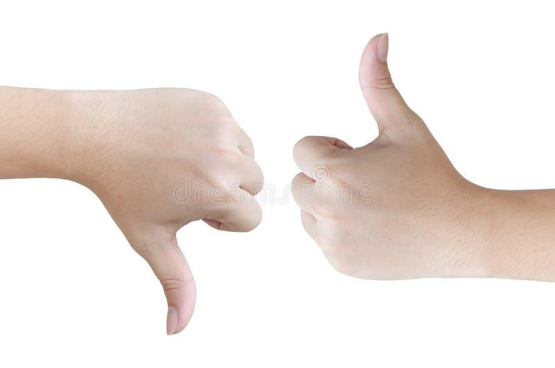 Las manos muestran como y aversión, en el fondo blanco fotos de archivo libres de regalías
