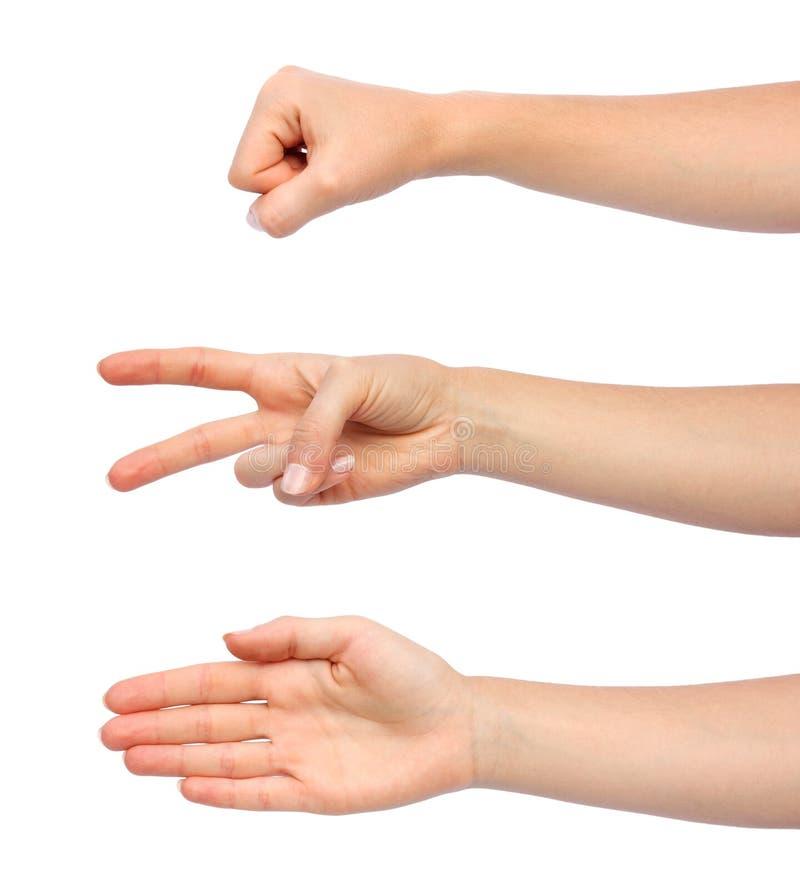 Las manos que hacen la roca scissors el papel fotografía de archivo libre de regalías