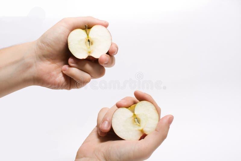 Download Las Manzanas Están En Manos Imagen de archivo - Imagen de pedazos, fondo: 7282933