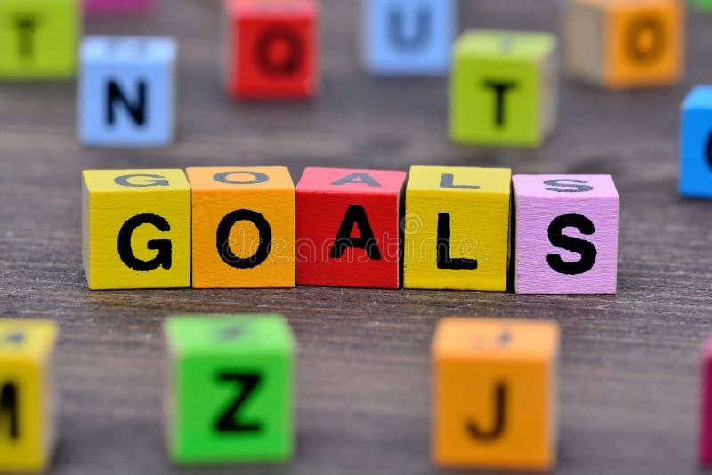 Las metas redactan en la tabla fotos de archivo libres de regalías