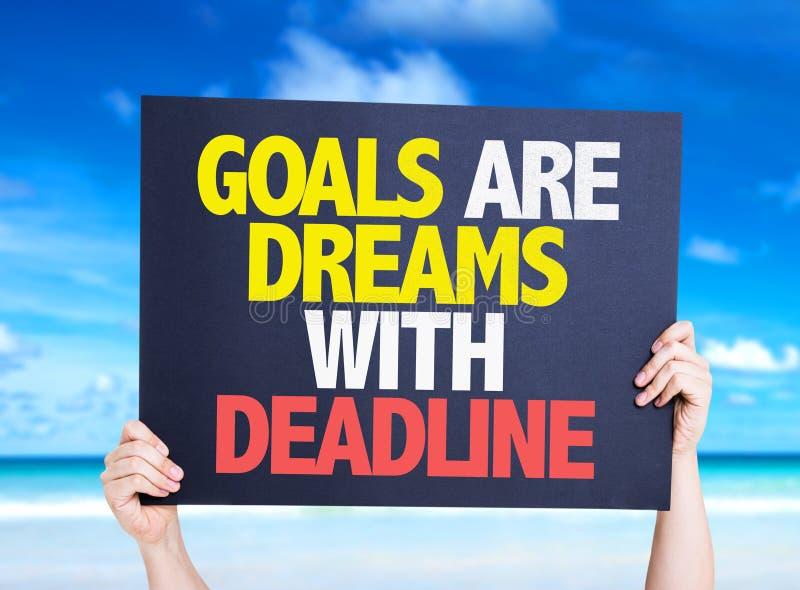 Las metas son sueños con la tarjeta del plazo con el fondo de la naturaleza fotos de archivo