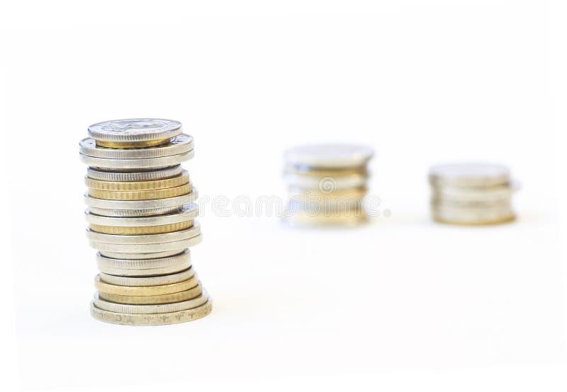 Las monedas se cierran para arriba foto de archivo libre de regalías