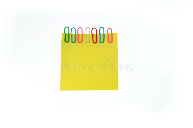 Las notas de papel amarillas son fijas imagen de archivo libre de regalías