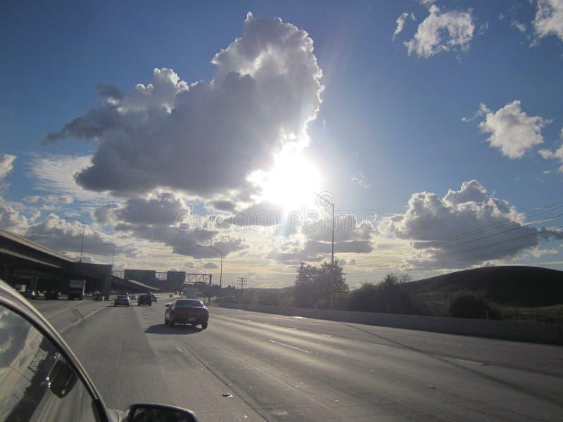 Las nubes tragan la carretera foto de archivo libre de regalías