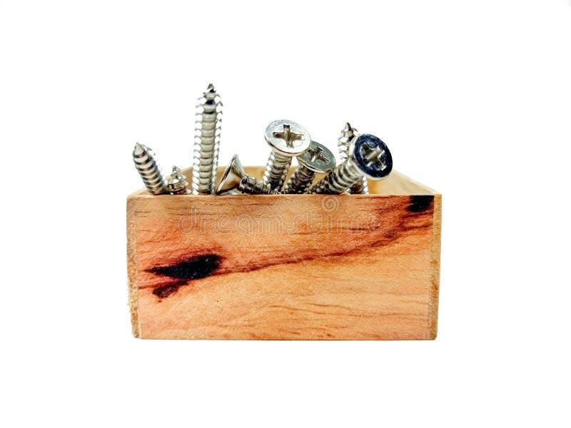 Las nueces del tornillo de la caja de madera foto de archivo libre de regalías