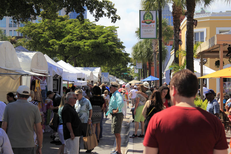 Las Olas Art Fair Crowds. FORT LAUDERDALE, FLORIDA - MARCH 1, 2014: Crowds of people peruse and enjoy the large variety of art for sale at the weekend long Las