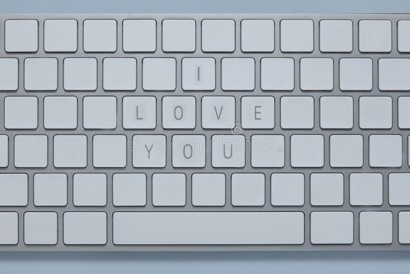 Las palabras te quiero en el teclado de ordenador con otros cierran suprimido fotografía de archivo libre de regalías