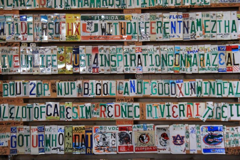 Las palabras a una canción de Kenny Chesney, pusieron así como piezas de las placas, flora-Bama, 2018 imagenes de archivo