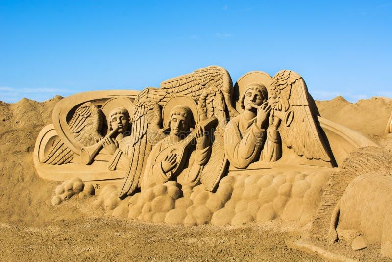 LAS PALMAS DE GRAN CANARIA, SPANJE - DECEMBER 9: De scène van de zandgeboorte van christus op het strand van Las Canteras royalty-vrije stock afbeelding