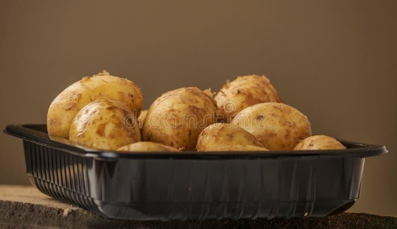 Las patatas se cierran para arriba fotos de archivo