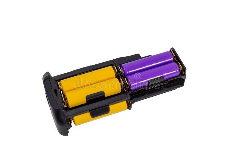 Las pilas AA del adaptador para la batería manejan la cámara moderna de DSLR imagen de archivo