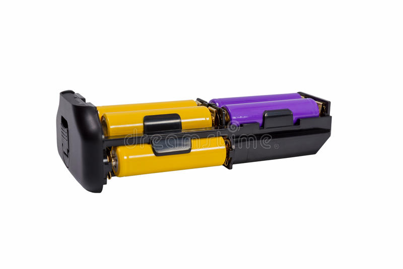 Las pilas AA del adaptador para la batería manejan la cámara moderna de DSLR foto de archivo libre de regalías