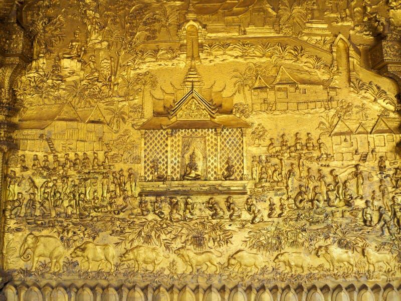 Las pinturas hermosas del bajorrelieve de los reyes del Lao en el pasado fotos de archivo