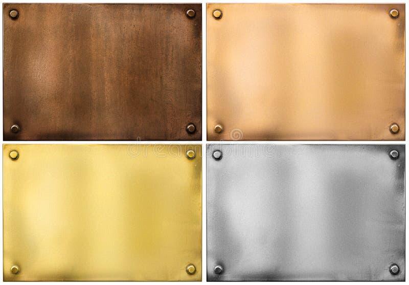 Las placas o los letreros de metal fijaron aislado en blanco imagen de archivo libre de regalías