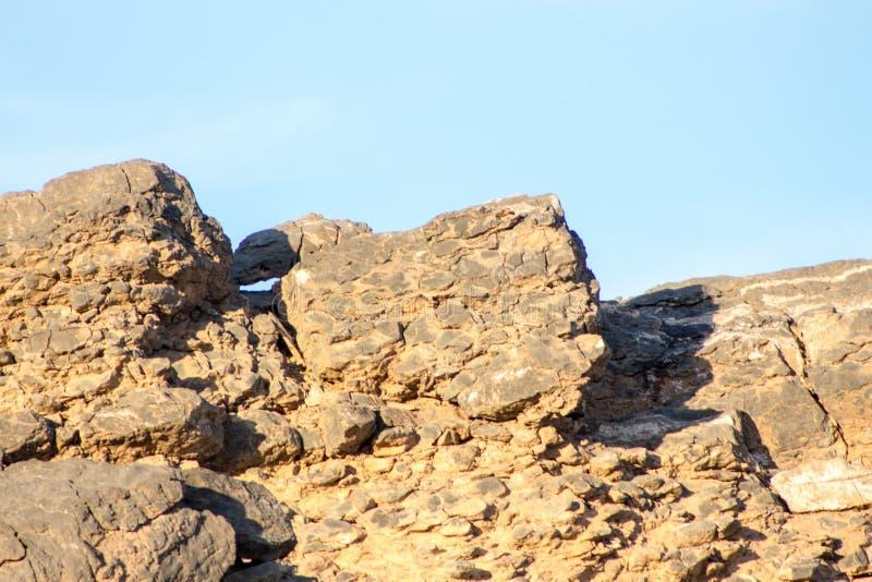 Las rocas y los ladrillos pesados naturales wallpaper la región de Mountaineous y imágenes de archivo libres de regalías