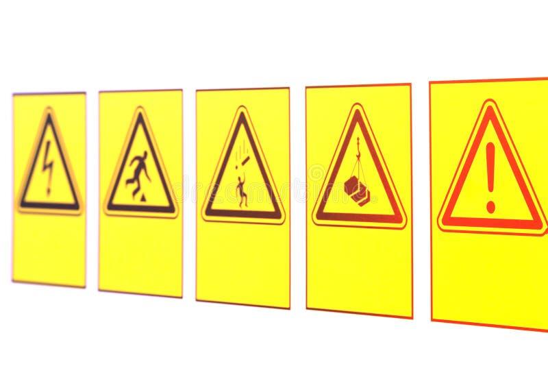 Las señales de peligro bajo la forma de triángulo imágenes de archivo libres de regalías