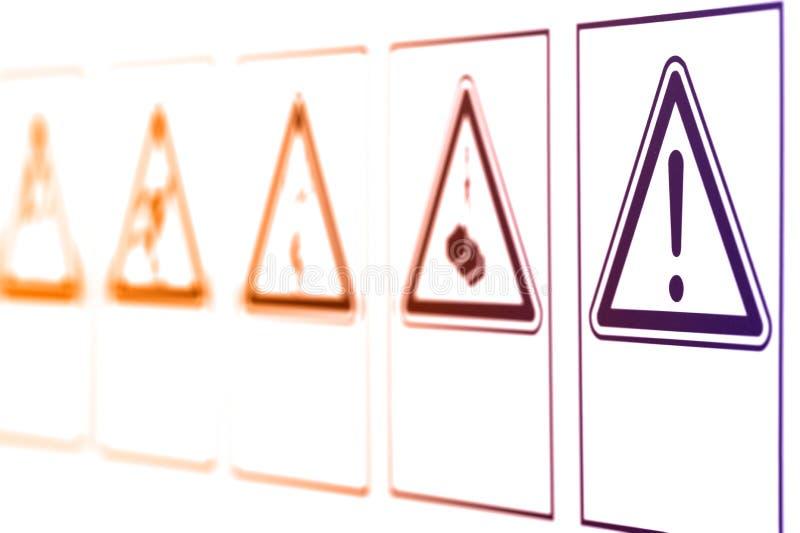 Las señales de peligro bajo la forma de triángulo imagen de archivo