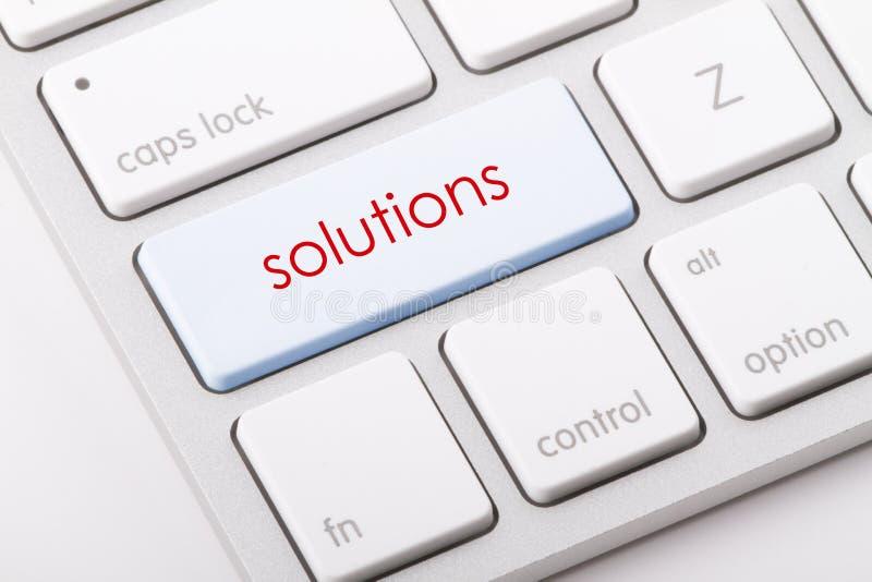 Las soluciones redactan en el teclado foto de archivo libre de regalías