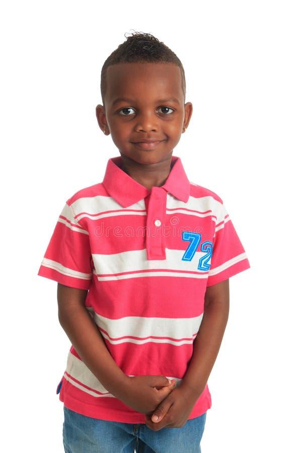 Las sonrisas negras afroamericanas del niño aislaron 1 imagen de archivo