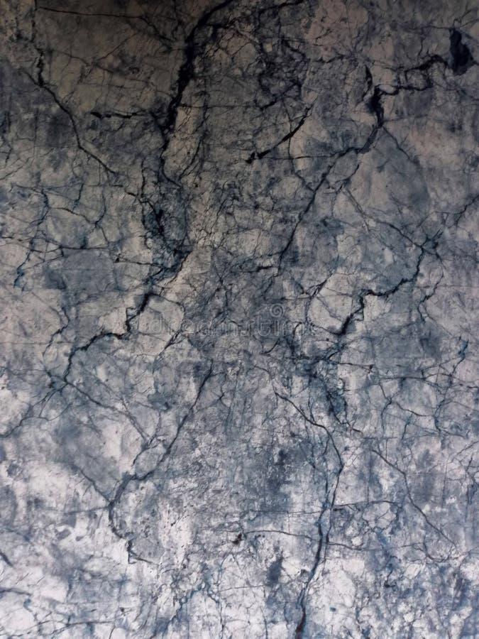 Las texturas superficiales abstractas hermosas colorean el piso de tejas blanco y negro del granito y el fondo y el papel pintado fotos de archivo libres de regalías