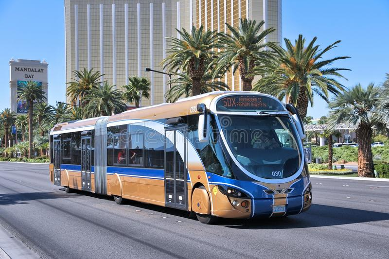 Las Vegas city bus. LAS VEGAS, USA - APRIL 14, 2014: People ride SDX bus in Las Vegas. SDX is operated by Wright StreetCar articulated hybrid bus manufactured by stock photos