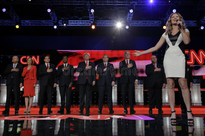LAS VEGAS - DECEMBER 15: Ayla Brown sings national anthem at Republican as presidential candidates hold hand over heart at preside. Ntial debate at Venetian, we stock photo