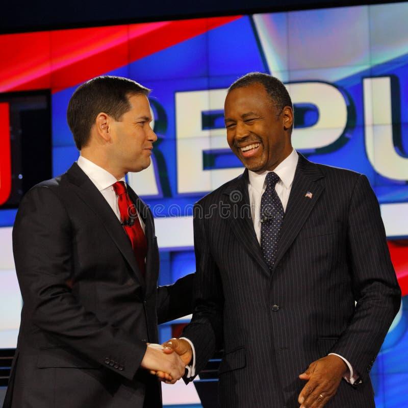 LAS VEGAS - DECEMBER 15: Republican presidential candidate former Dr. Ben Carson shakes hands with Senator Marco Rubio at CNN repu stock photo