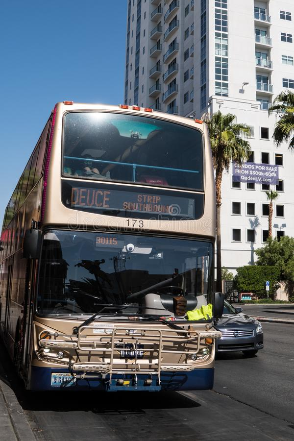 Las Vegas, Nevada - Double decker Deuce bus picks up passengers in downtown Las Vegas. This is a popular route. Double decker Deuce bus picks up passengers in stock photos