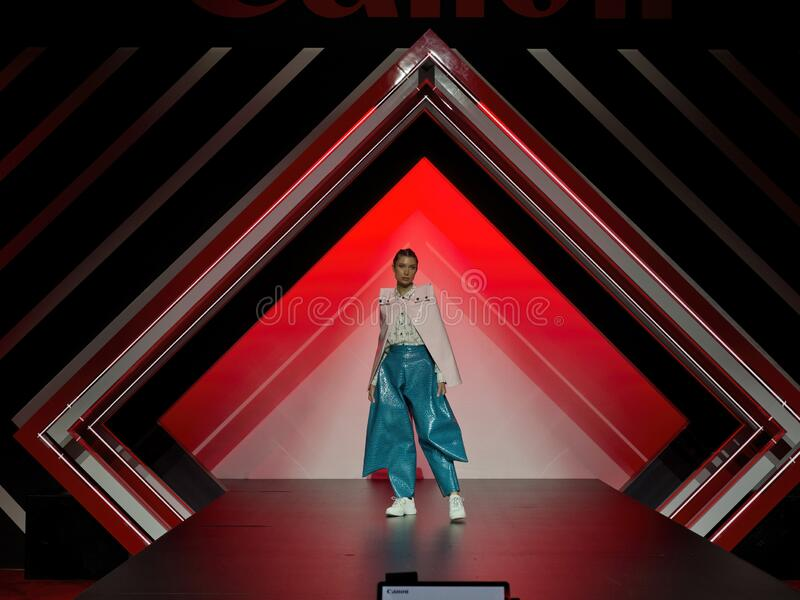 Beautiful young female model at a fashion advertising Cannon cameras. LAS VEGAS, NEVADA - January 9, 2020: Beautiful young female model at a fashion advertising stock image