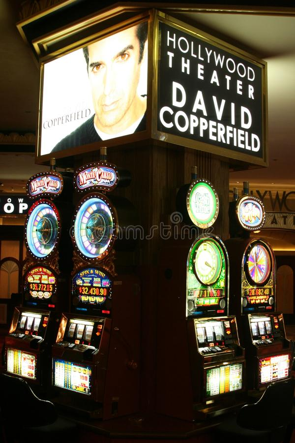 LAS VEGAS NEVADA, USA - AUGUST 18. 2009: View on slot machines in a Casino with advertising for David Copperfield show stock image