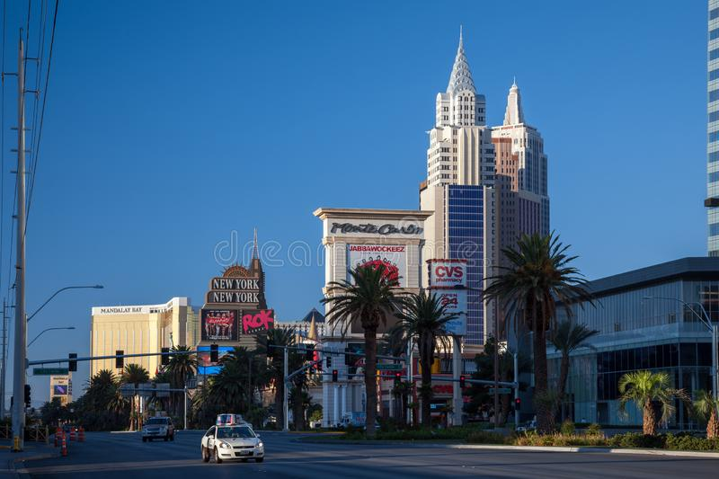 View at sunrise of hotels in Las Vegas Nevada on August 1, 2011. Three unidentified people royalty free stock photos