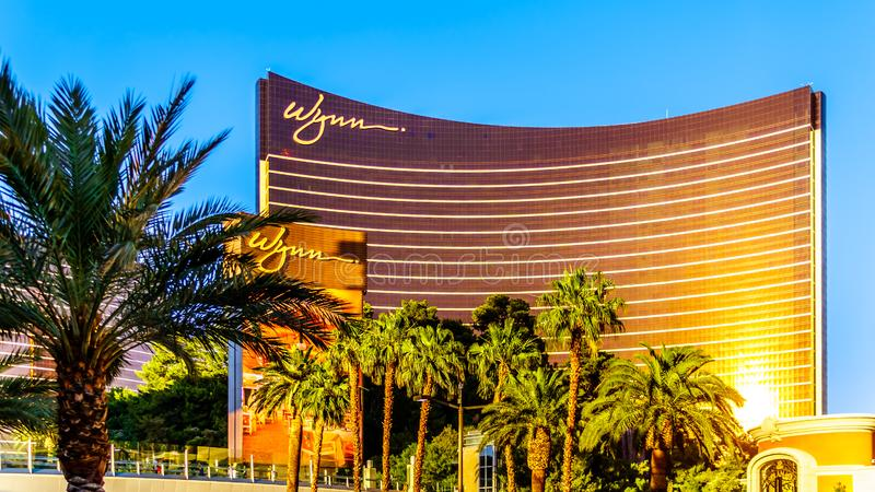 Late afternoon sun reflecting on the Glass of the modern building of Wynn Resort and Casino on Las Vegas Blvd, called `The Strip`. Las Vegas, Nevada/USA - June 8 royalty free stock photo