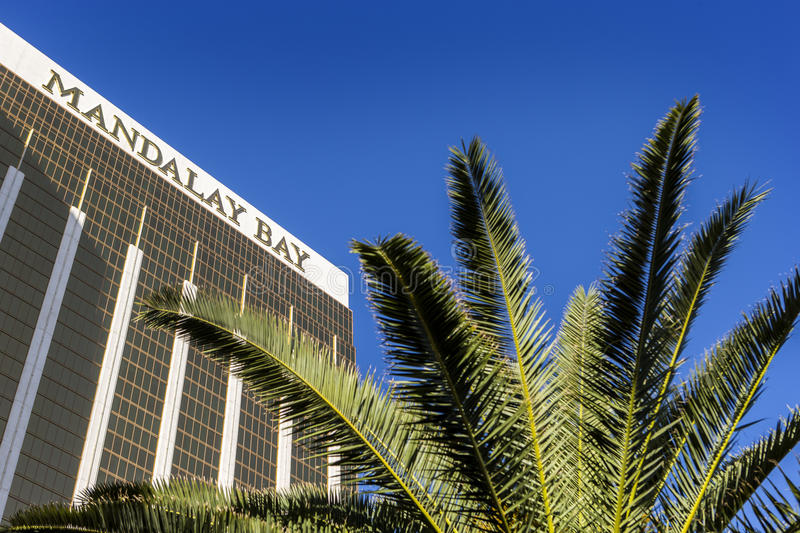 Las Vegas, Nevada/USA-03/22/2016 Mandalay Bay Casino and Hotel luxury resorts in Las Vegas, with a palm tree. royalty free stock photos