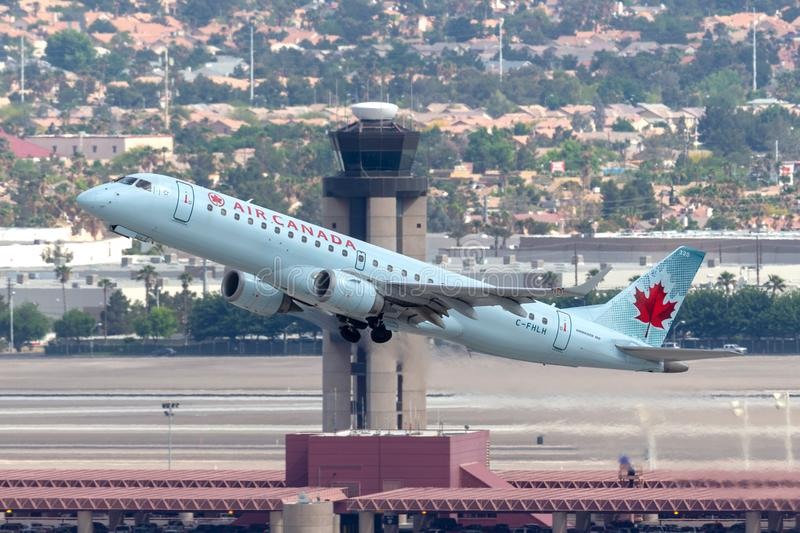 Air Canada Embraer ERJ-190 regional airliner jet taking off from McCarran International Airport in Las Vegas. Las Vegas, Nevada, USA - May 8, 2013: Air Canada royalty free stock photography
