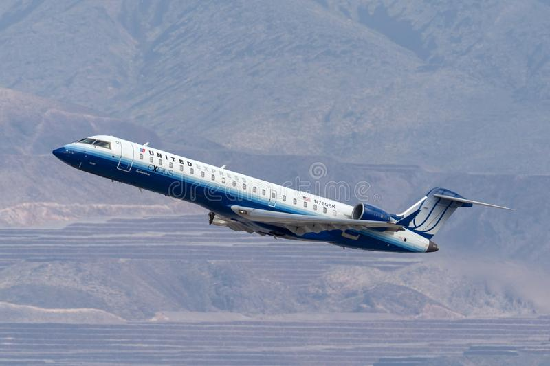 United Express Bombardier CRJ-701ER regional jet airliner taking off from McCarran International Airport in Las Vegas. Las Vegas, Nevada, USA - May 8, 2013 stock photo
