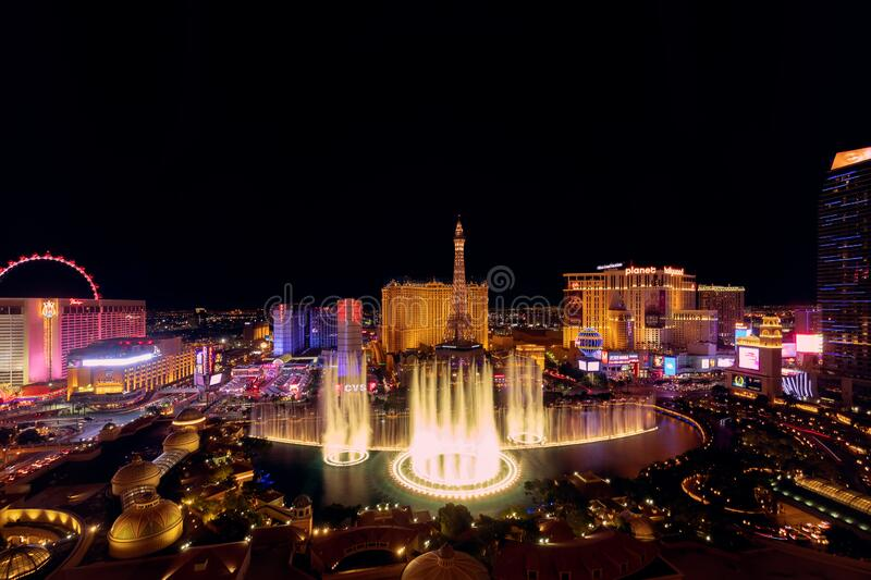 Las Vegas, Nevada, USA - October 31, 2019: Night view of Las Vegas Bellagio Hotel and Casino fountain and other hotels on Strip. View from Bellagio Hotel stock photography