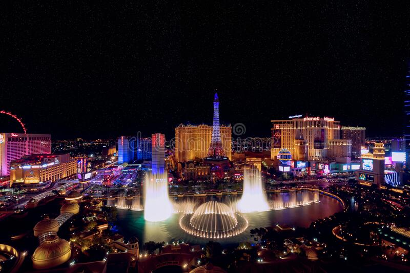 Las Vegas, Nevada, USA - October 31, 2019: Night view of Las Vegas Bellagio Hotel and Casino fountain and other hotels on Strip. View from Bellagio Hotel stock image