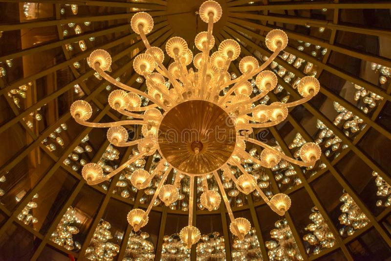 Close-up Chrystal Chandelier at Luxury Bellagio Casino and Resort in Las Vegas. Las Vegas, NV - January 9, 2019: Close-up photo of chrystal chandelier at luxury royalty free stock image
