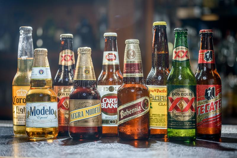LAS VEGAS, NV - JULY 17, 2016: Popular Mexican Beers. Pacifico,. Corona, Bohemia, Tecate and Modelo beer bottles on a bar counter top royalty free stock images