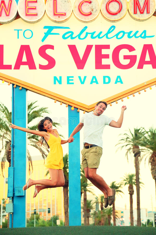 Las Vegas Sign - Happy people jumping stock photo