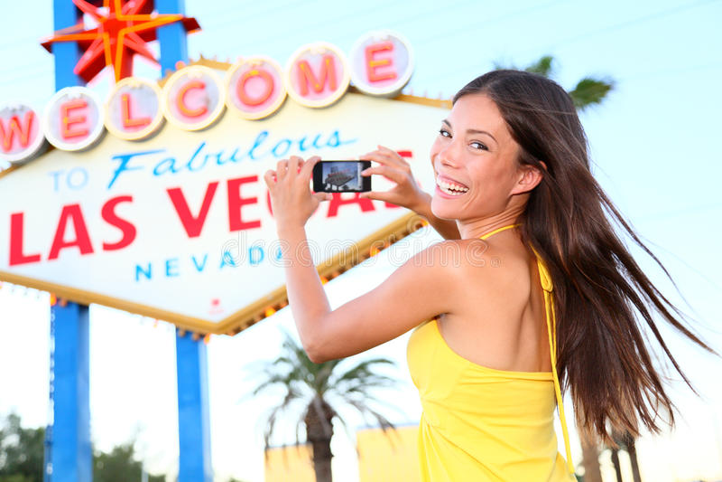 Las Vegas Sign tourist woman happy taking photo royalty free stock photography